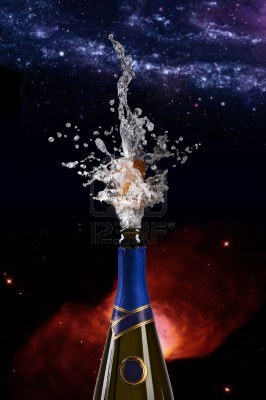 6015970-champagne-bottle-with-shooting-cork-on-space-background